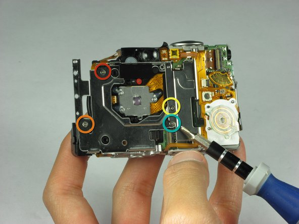 Remove four screws located on the back of the camera: