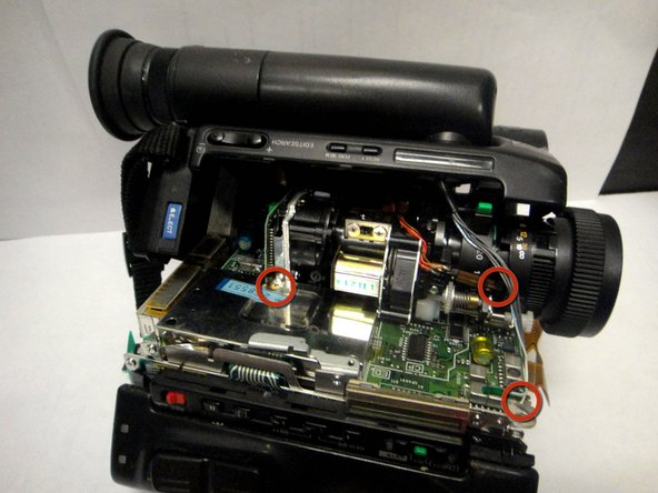 Remove (3) electrical connecters in order to pull side cover away from camcorder to expose back side of viewfinder.