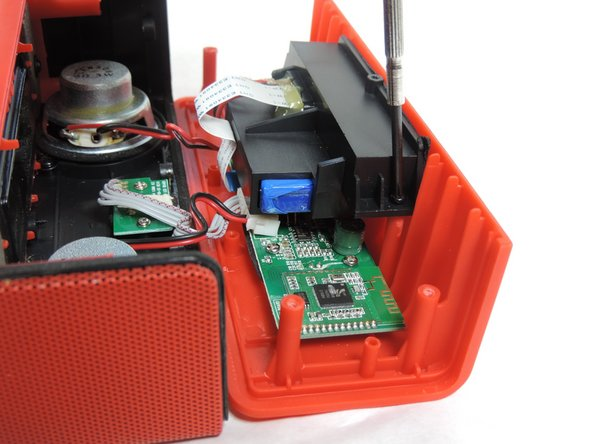 Image 2/2: Removal of battery compartment is necessary to prevent electric shock when replacing the woofer.