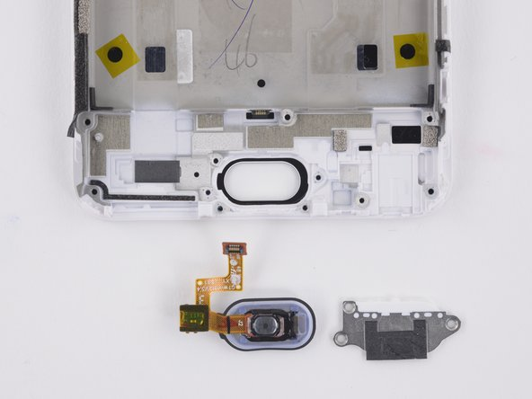 Next removable components are the home button bracket, followed by home button.