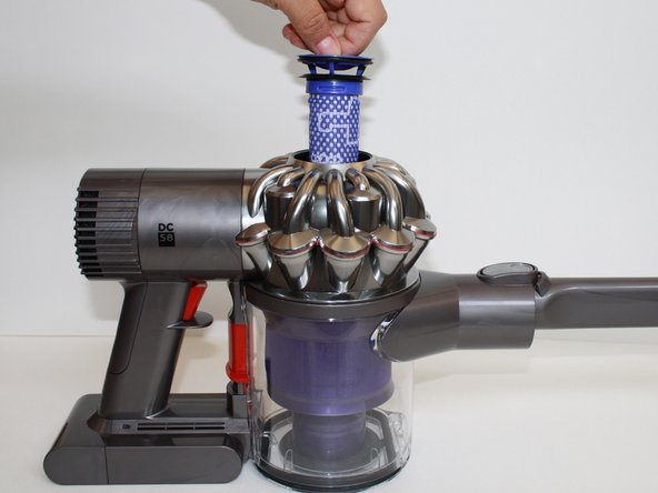 Gently lift the filter up and out of the center of the vacuum cyclone (the silver part at the top of the vacuum).
