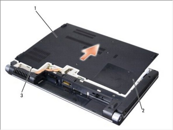 Loosen the seven captive screws on the base cover and lift the cover off the computer at an angle as shown in the figure.