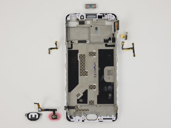 The display assembly final components are fairly easily removed: home button bracket, home button, button cables, vibrator, earpiece speaker.