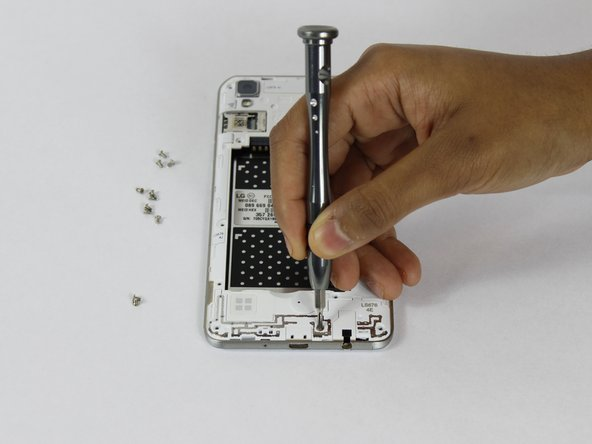 Remove the twelve 2mm JIS #00 screws from the mid-frame.