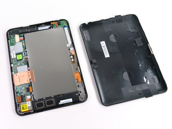 Pry the case apart and run the plastic opening tool along the perimeter of the Kindle Fire to release the clips securing the case halves to each other.
