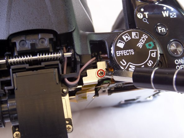 Use a Phillips screwdriver and remove the single 6.350 mm screw, left of the mode-adjustment dial.