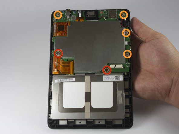 With the Phillips #00 screwdriver, remove the following screws securing the motherboard to the back panel: