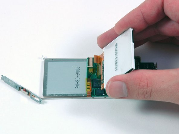 Image 1/1: Slide the display ribbon out of its connector and lift the display off of the logic board.