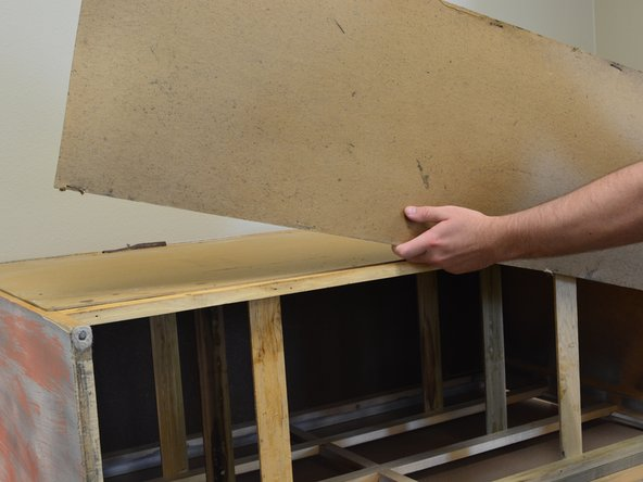 Remove the piece of hardboard and realign it so that it is in the position you desire.