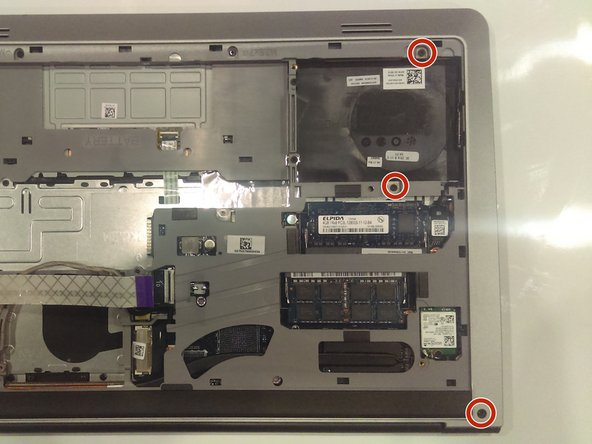 Using the Phillips J0 screwdriver, remove  all the screws from the case. There is a total of 16 screws.  CAUTION: The bottom left screw does not remove from the laptop.