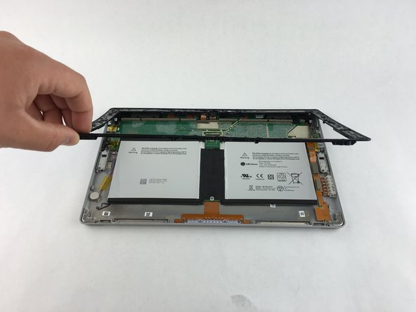 Remove ten 3.45 mm T3 screws from the corners of the black plastic bezel.