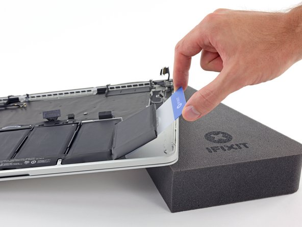 Leave the plastic card underneath the battery cell to prevent it from re-adhering as you proceed to the next step.