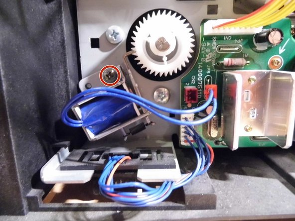 Then remove the Philips screw and remove the feed breaker.