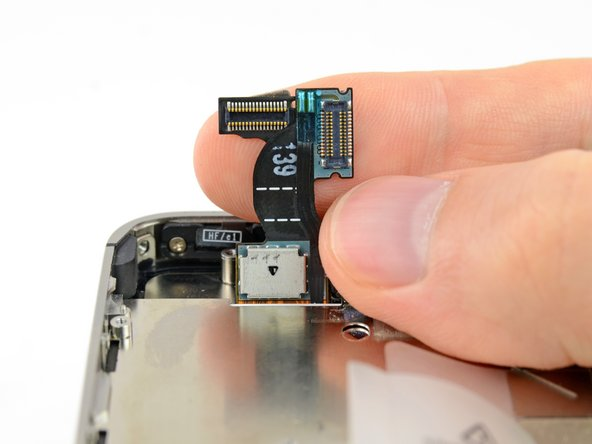 Carefully straighten the digitizer and LCD data cables, and feed them through the slot cut in the outer case.