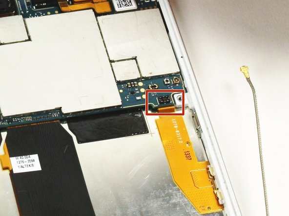 Disconnect the ribbon cable at the bottom right of the motherboard. (It's shown tucked under the motherboard in this photo, which is incorrect—don't do this!)