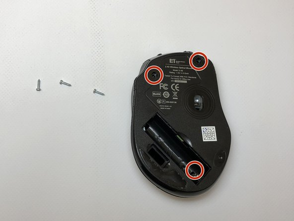 Remove three screws. Two screws are located under the adhesive pads closer to the front of the mouse. The third screw is under the battery cover.