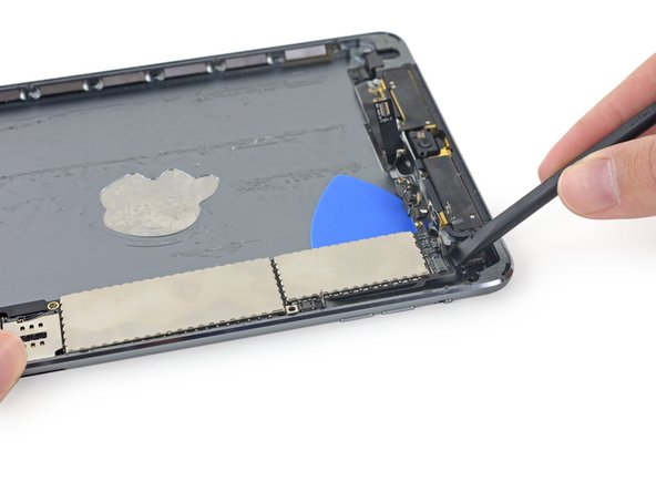 Image 2/2: Be extremely careful not to damage the rear-facing camera cable, or any logic board components.