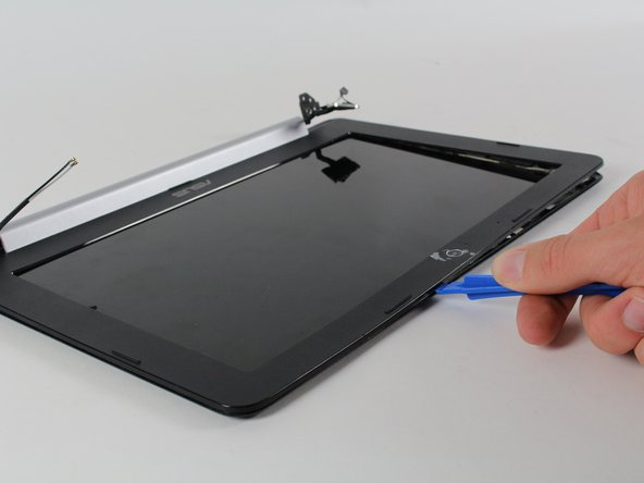 You should hear snapping sounds and the screen cover should be hanging off the frame with the bottom edge still connected.