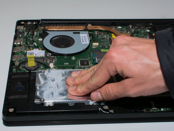 Take hard drive out of the port by sliding the component to the left.