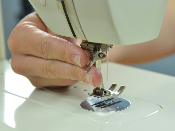 Set the sewing machine needle to the upright position by turning the balance wheel towards you.
