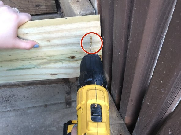 Secure your wood piece (riser) into place using a drill and galvanized screws.