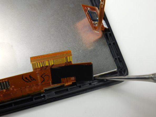 Use the metal spudger to leverage and lift the metal board from the glass paneling around the perimeter of the device.