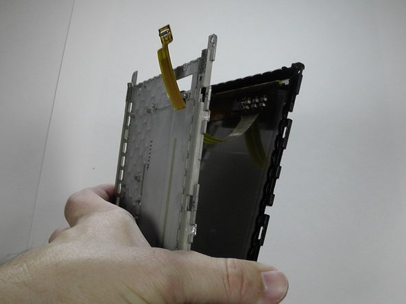 With the clips separated, gently guide the Screen's Motherboard Connector through the hole.