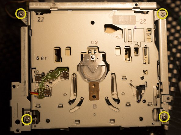Flip the unit over to remove four 6 mm T9 Torx screws.