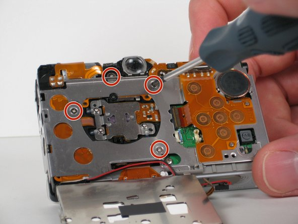 Remove the four 2.6 mm Phillips screws located underneath where the LCD screen used to be.