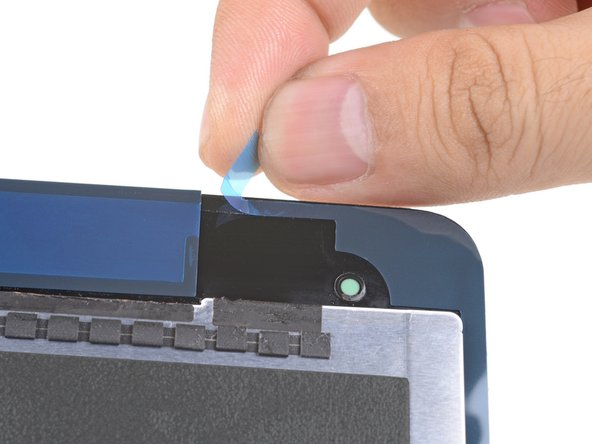 Peel and remove the three colored plastic liners to expose the adhesive.