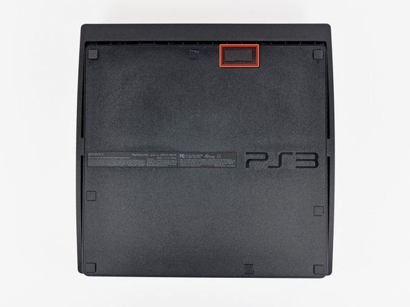 Image 1/2: Turn the PS3 over and lay it on its backside.