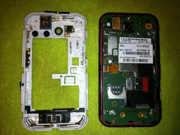 Remove the the back case (white section) revealing the logic board.