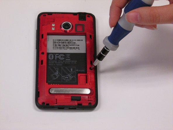 Remove the six screws on the back of your phone with the T5 screwdriver. Be careful not to lose the screws.