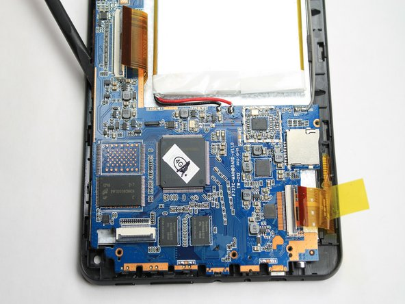 Image 1/3: The battery is still attached to the logic board. Be careful to not tear the two apart during removal.