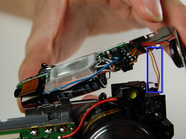 Image 3/3: Note: There is a yellow and orange wire soldered onto the camera. Be careful not to pull them off.