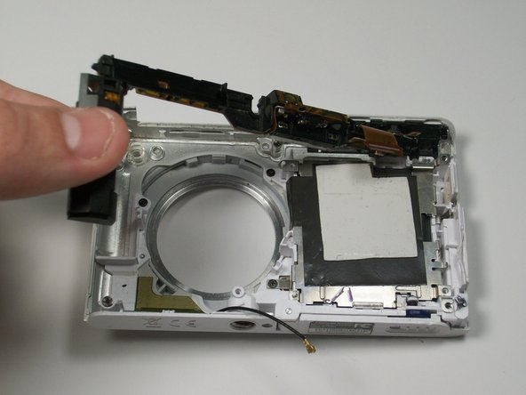 Beginning with the battery on the side, gently pull upwards to remove the entire flash bulb assembly.