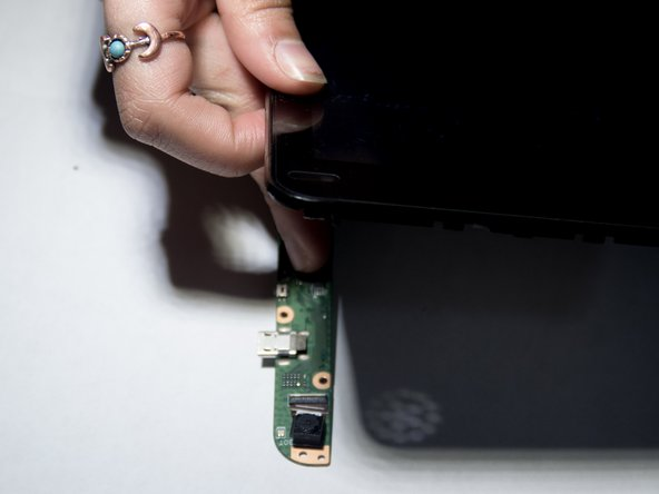 Flip the device upwards.