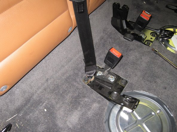 "Image 1/3: Set the passenger side of the rear seat near it's final position (I set mine up on the ledge of the ""trunk"")."