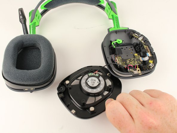 Lift the speaker module up off the device.