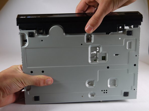Grasp the front case firmly and lift from the rest of the device.