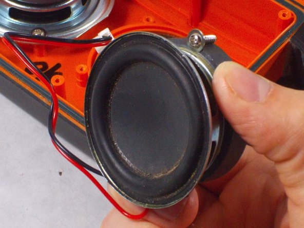 To replace the cone, remove the existing one by peeling it off of the speaker with needle nose pliers.