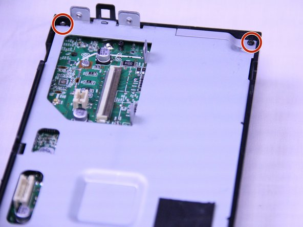 Remove the two 2mm Phillips #0 screws from the back plate.