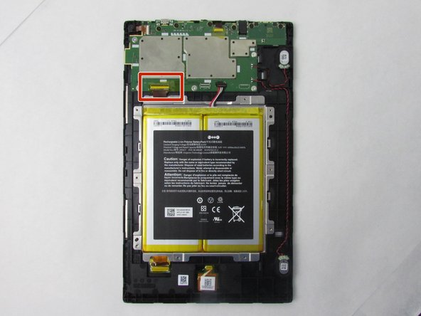 After removing the casing, flip the tablet over so the screen is facing down.