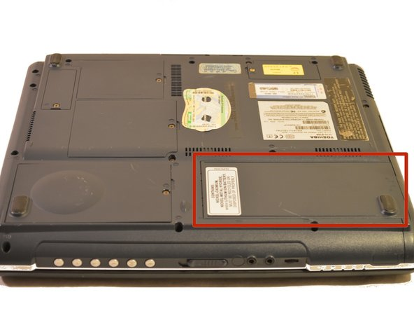 The battery is located on the front right corner of the laptop.