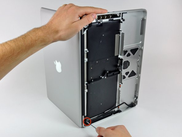 Open your MacBook so the display is perpendicular to the upper case.