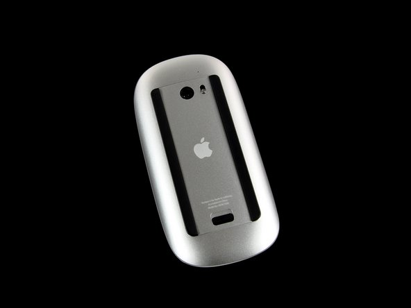 Image 1/1: The Magic Mouse is composed of an aluminum base topped off with a smooth multitouch panel, giving it a lustrous buttonless appearance.