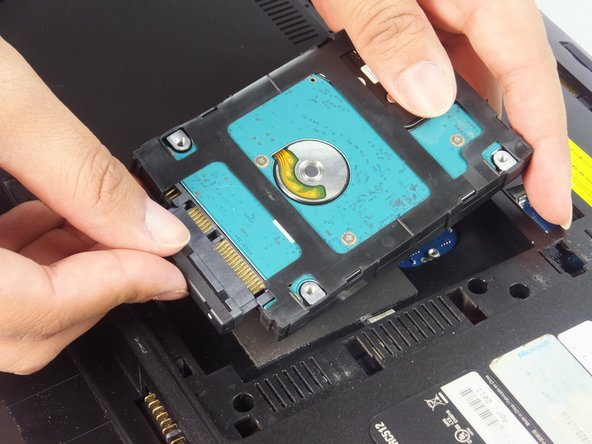 Image 1/1: Carefully pull the HDD away from the connector.
