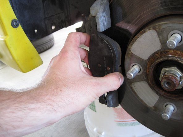Pull the outer brake pad from the mounting bracket.