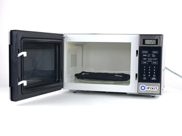 Image 1/2: Place the iOpener in the center of the microwave.