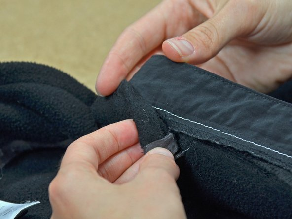 Image 1/3: Holding the backside of the collar fabric in place, turn the collar back to the front side.
